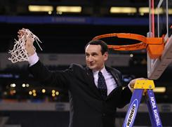 Mike Krzyzewski cuts down the net after Duke's 61-59 victory against Butler in last year's national championship game.